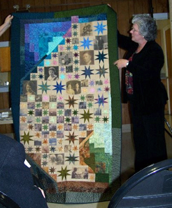 Kathy Lincoln showing her quilt, Voyages